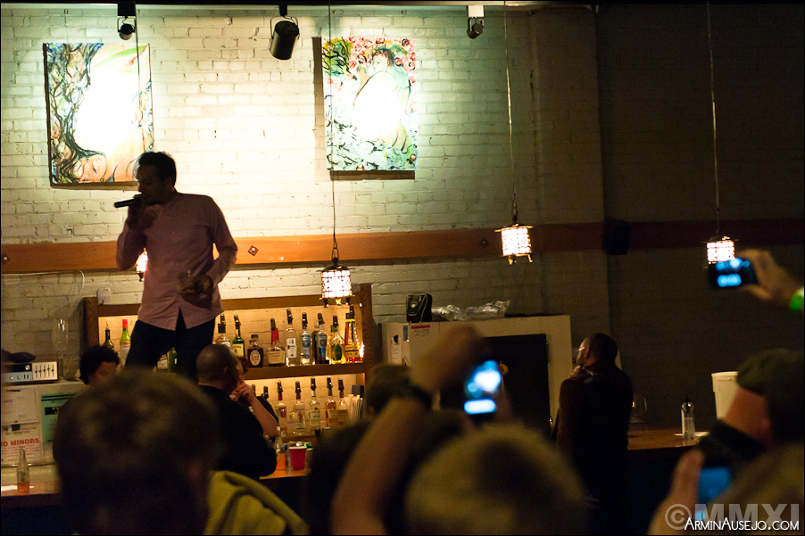 Sabzi performing on top of the bar in the back